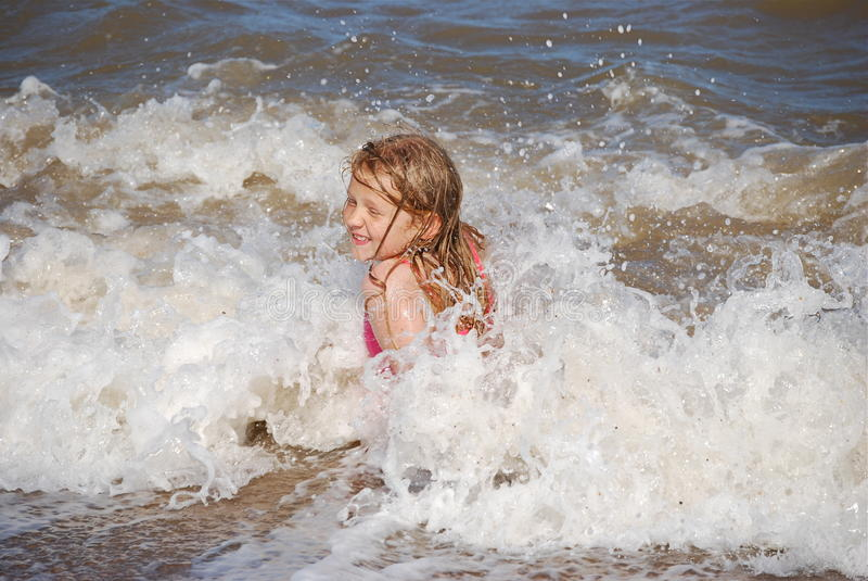 Download Blonde Girl Enjoying The Waves Stock Photo - Image: 12619710