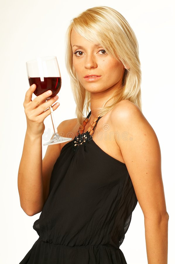 Blonde girl with glass of wine stock image