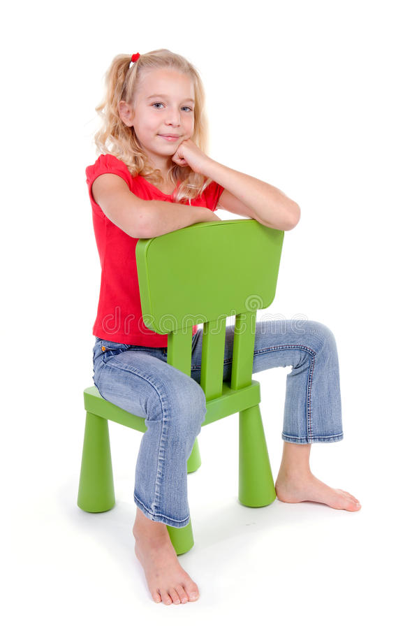 Blonde Girl On Green Chair Royalty Free Stock Photos