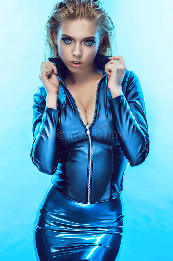 Free Blonde Girl In Tight Blue Clothes Royalty Free Stock Photo - 70455745