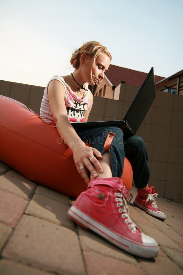 Blonde girl looking at laptop