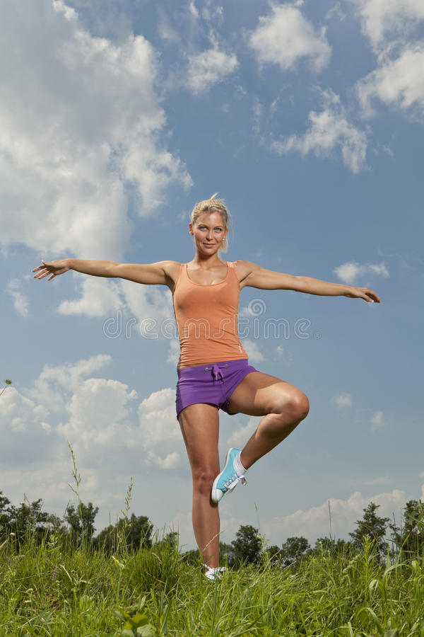 Blonde girl in nature park, fitness program royalty free stock photos