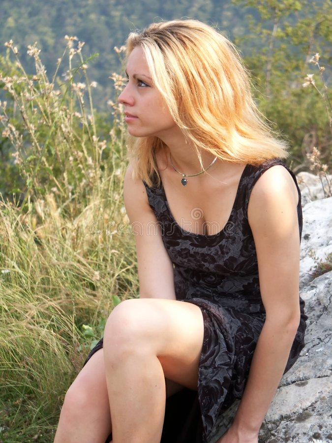 Blonde girl outdoors stock photo