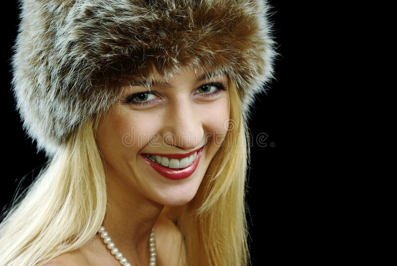 Blonde girl in pearl necklace royalty free stock photography
