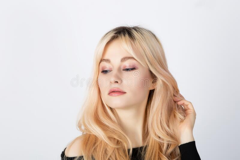 Blonde girl with pink eye shadows on her face stock photo