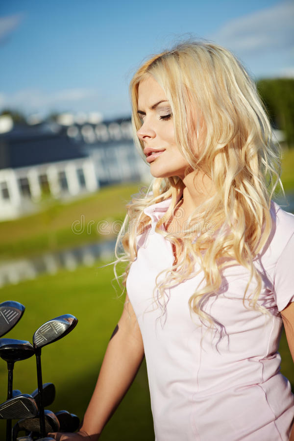 Download Blonde girl play golf stock image. Image of eyes, girl - 19603845
