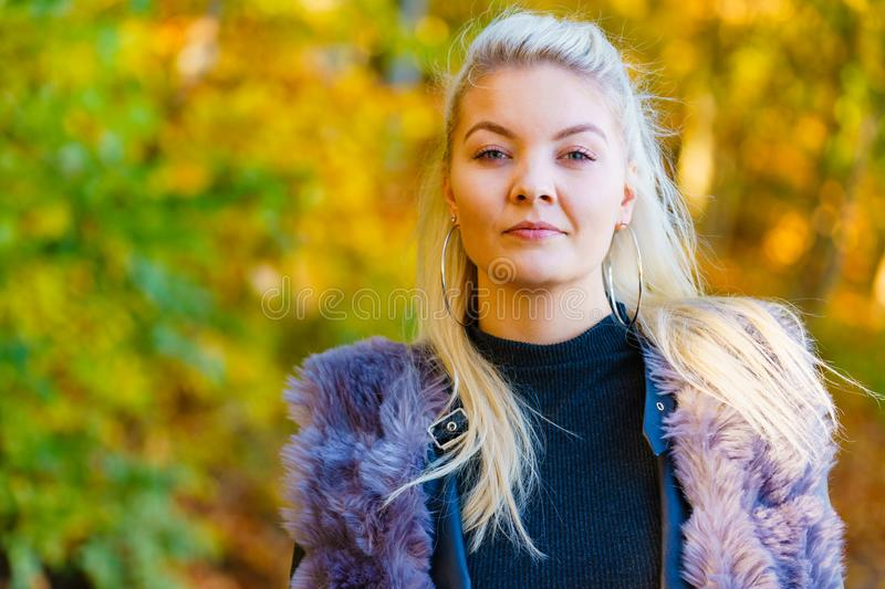 Blonde girl portrait outdoor at sunny day royalty free stock photography