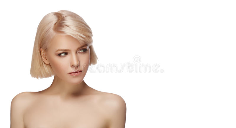 Blonde girl portrait. Blonde girl with perfect skin and short haircut looking aside, studio portrait isolated on white background stock photography