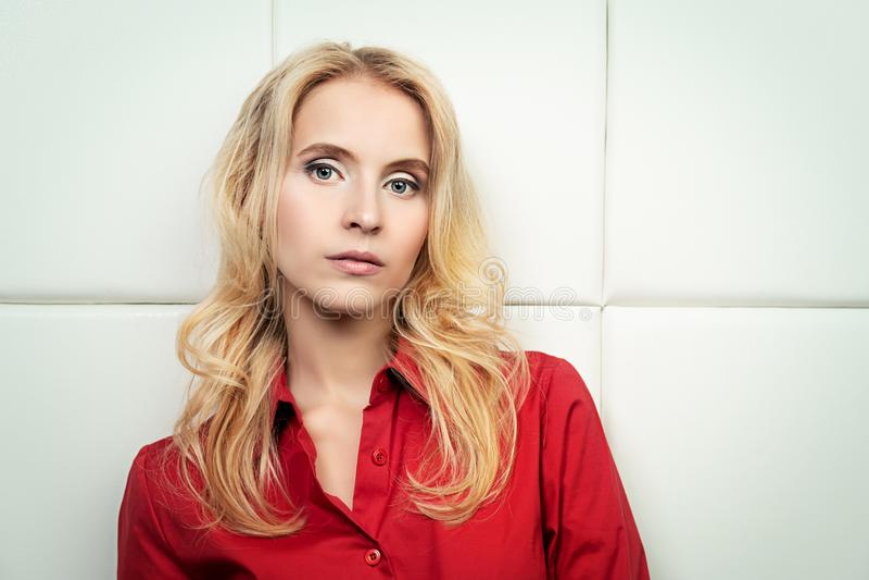 Blonde girl in shirt stock image