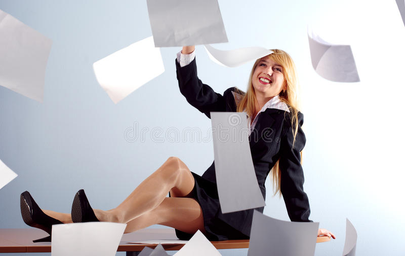 Blonde girl throwing white sheets stock photo