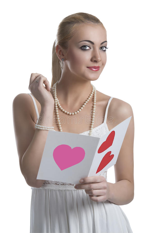 Blonde girl with valentine postcard looks in to the lens royalty free stock images