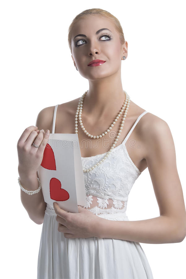 Blonde girl with valentine postcard looks up royalty free stock photos