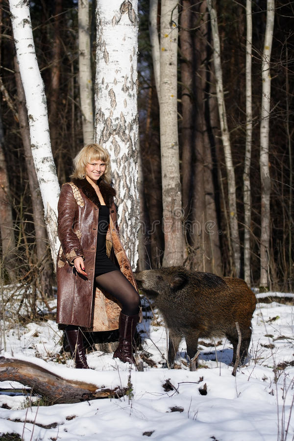 Download Blonde Girl With Wild Boar Royalty Free Stock Photos - Image: 9702578