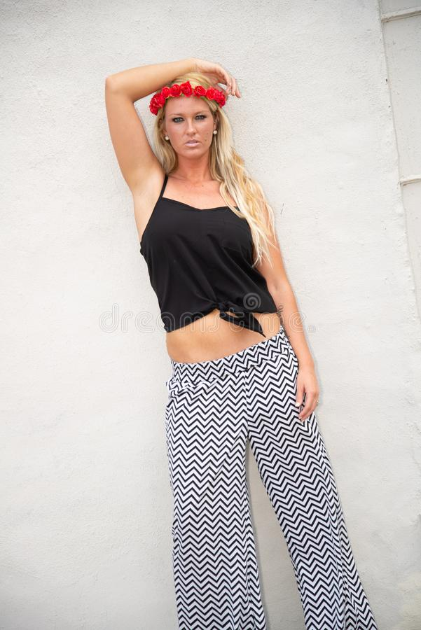 Blonde girl woman. Fashion model in sexy trendy clothes in urban setting stock photography