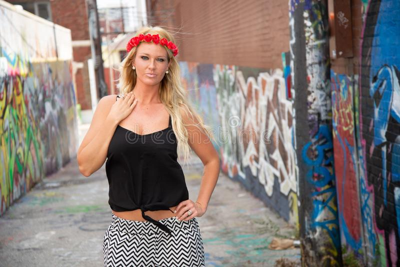 Blonde girl woman. Fashion model in sexy trendy clothes in urban setting stock image