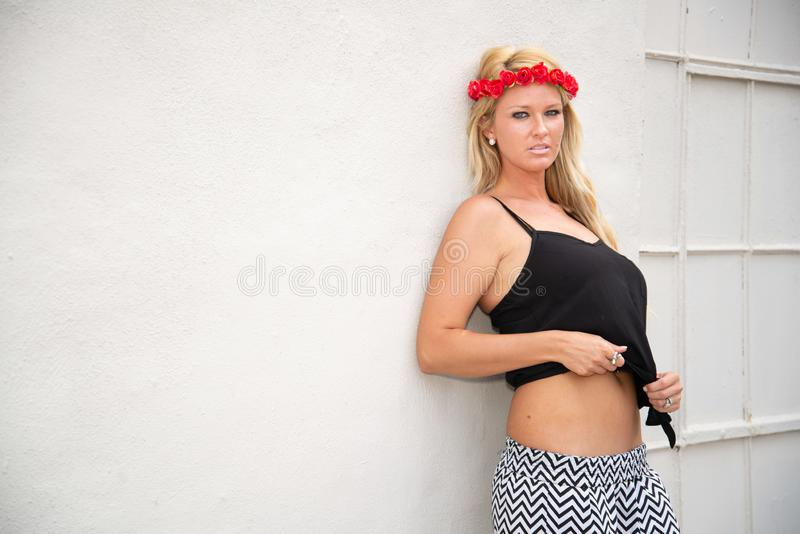 Blonde girl woman. Fashion model in sexy trendy clothes in urban setting royalty free stock photos