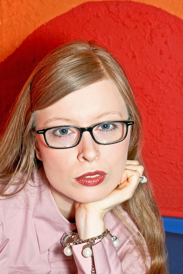 Blonde with glasses royalty free stock photo