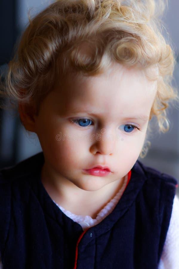 Blonde gorgeous baby girl. Close ip of blonde blue eyed baby girl royalty free stock photos