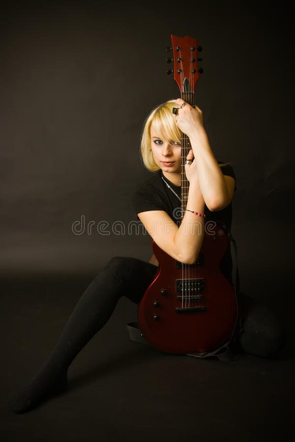 Blonde And Guitar stock photography