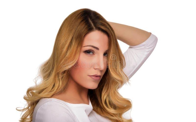 Blonde hair model woman. Female portrait. Studio shot. Blonde hair model woman. Female portrait on white background. Studio shot stock photography