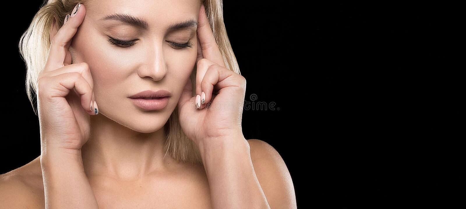 Blonde hair woman with beauty face skin over dark background female portrait stock photo
