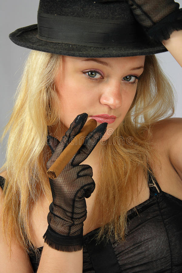 Blonde in hat with cigar royalty free stock photo