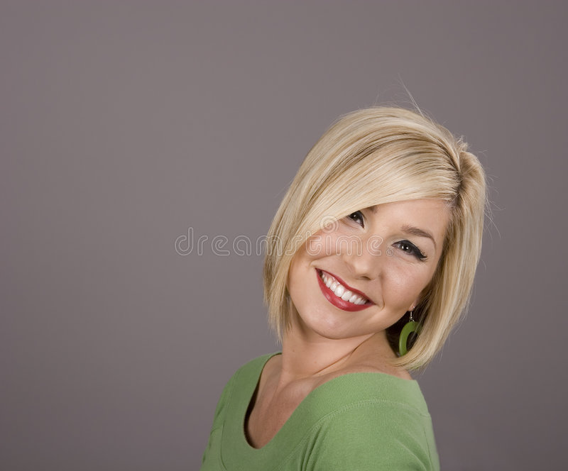 Blonde Head Tilted with Big Smile stock photo