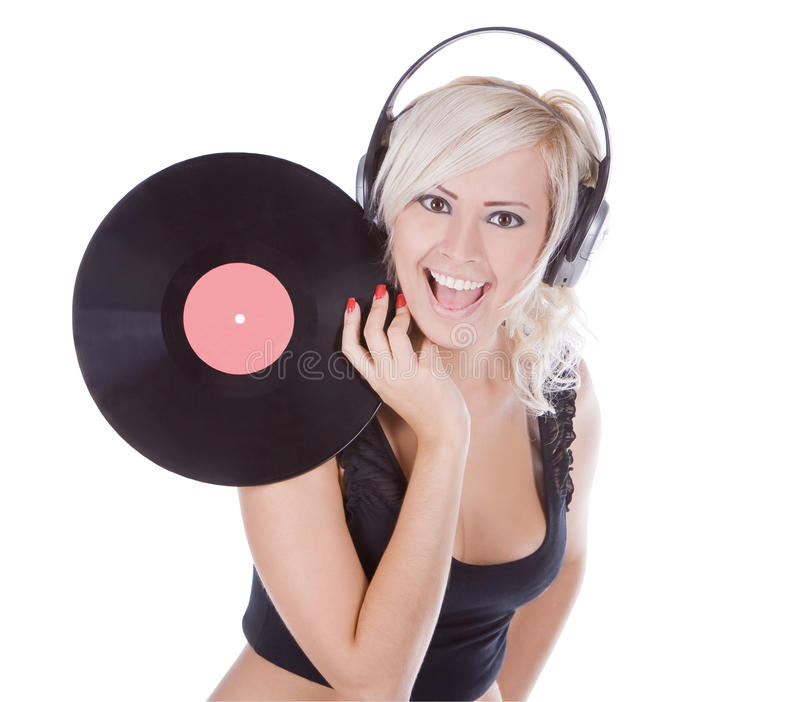 Blonde in headphones with vinyl record royalty free stock images