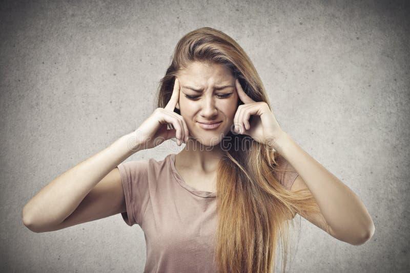 Blonde Kopfschmerzen lizenzfreie stockbilder
