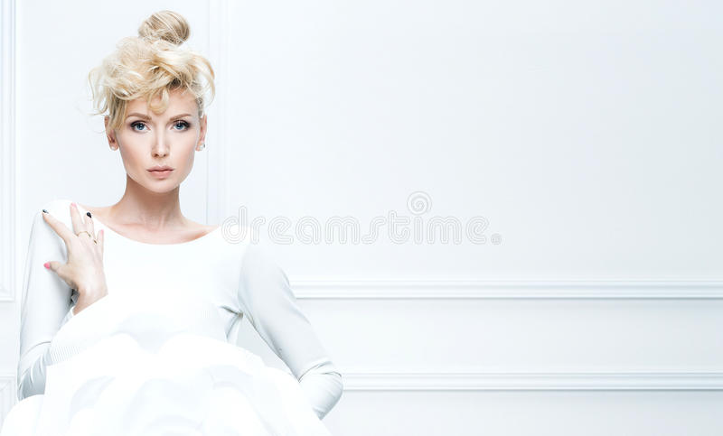Blonde lady with big white flower. stock photo