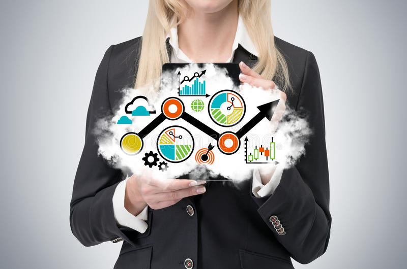 A blonde lady is holding a cloud with a business strategy flow chart. royalty free stock images
