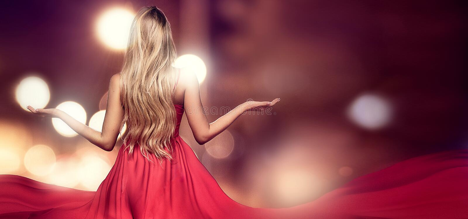 Blonde lady in red elegant maxi dress. royalty free stock photos