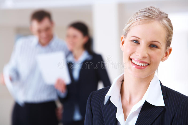 Blonde leader. Portrait of blonde businesswoman looking at camera in working environment royalty free stock photo