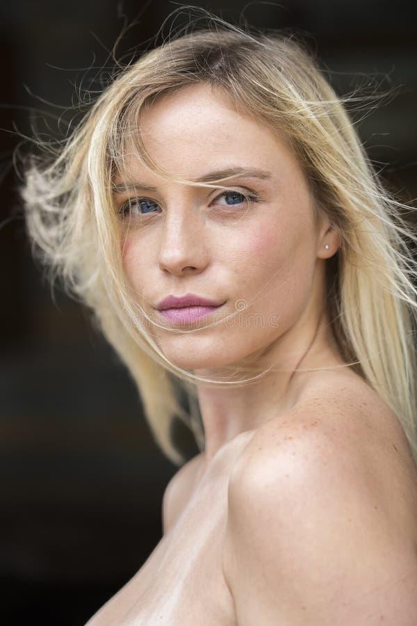 Blonde Model Posing Outdoors royalty free stock photo