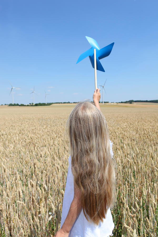 Blonde little girl and ecology stock photography