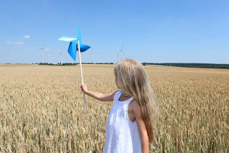 Blonde little girl and ecology stock image