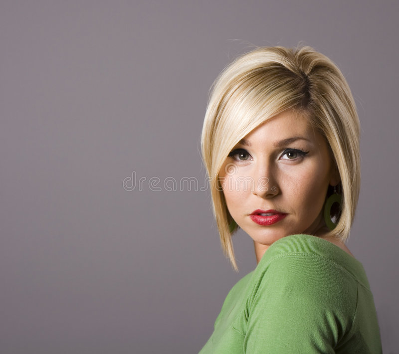 Blonde Looking at Camera royalty free stock photography