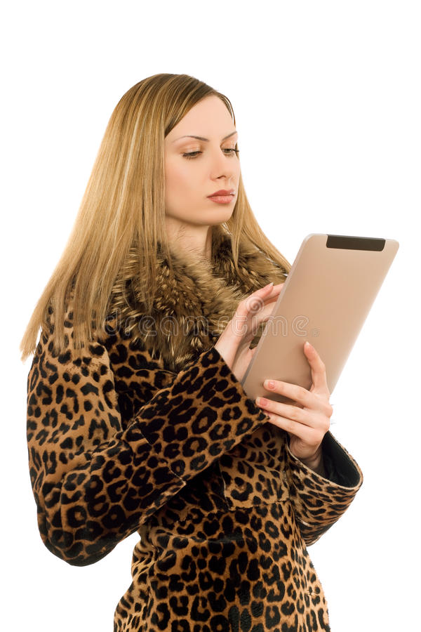 Blonde looking at the tablet pc stock photography