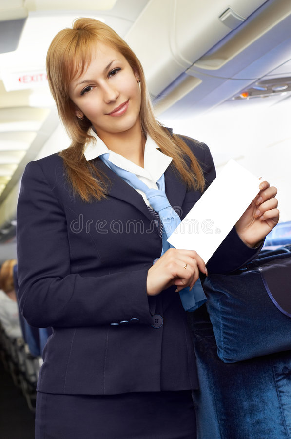 Blonde luchtstewardess (stewardess) stock foto