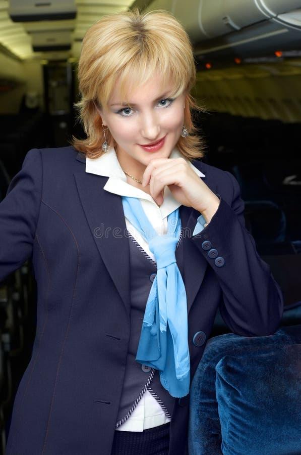 Blonde Lufthosteß stockfotografie