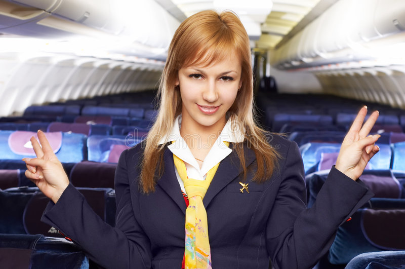 Blonde Lufthosteß (Stewardess) stockbild