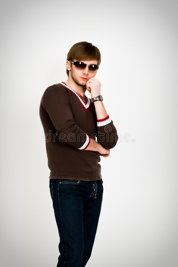 Blonde Man In Modern Sweater And Sunglasses Royalty Free Stock Images