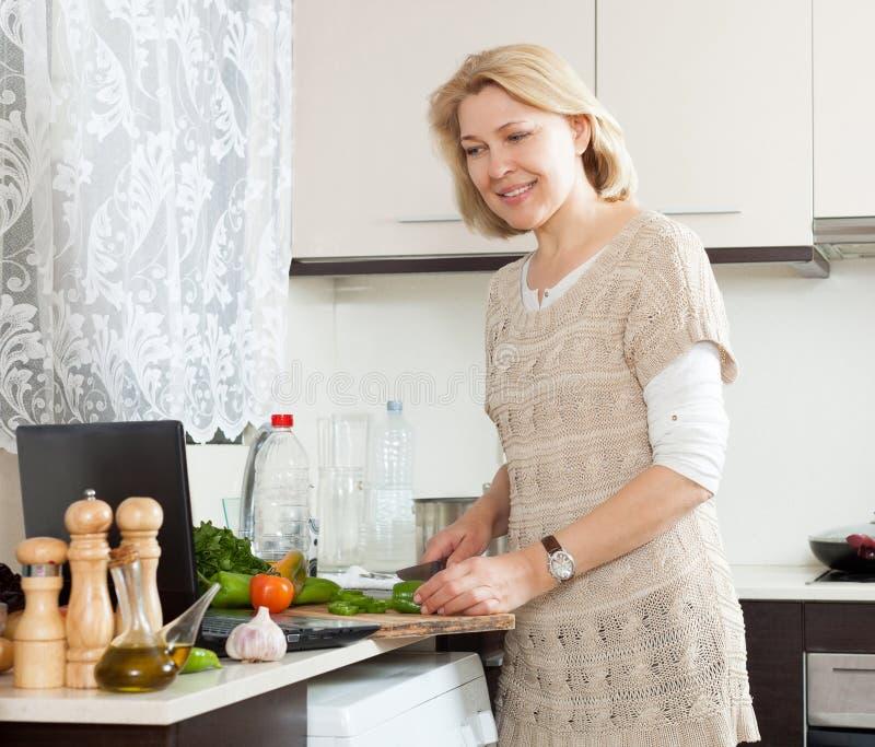Blonde in kitchen mature