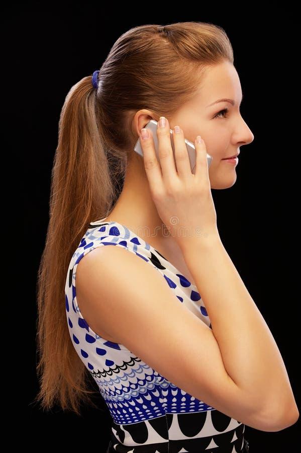 Blonde met cellphone royalty-vrije stock afbeelding