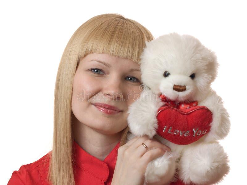 Blonde met een pluchestuk speelgoed royalty-vrije stock foto