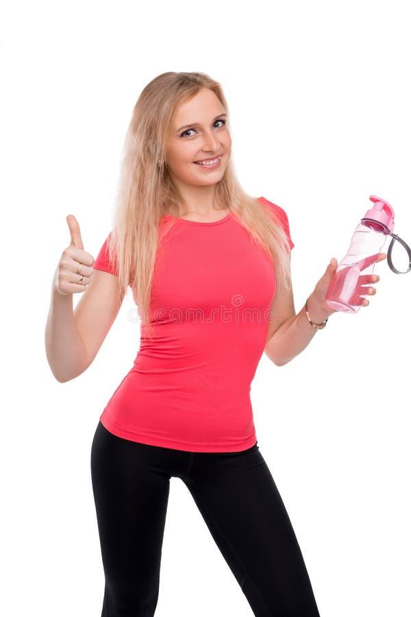 Blonde mince dans la vue d'isolement cultivée par vêtements de sport photos libres de droits