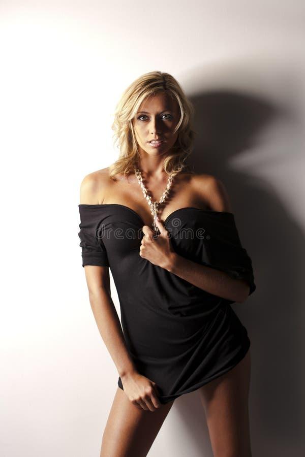 Blonde Model in Black Dress royalty free stock image
