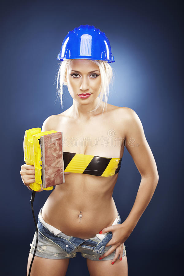 Download Blonde Model With An Electric Sander. Stock Photo - Image: 20919208