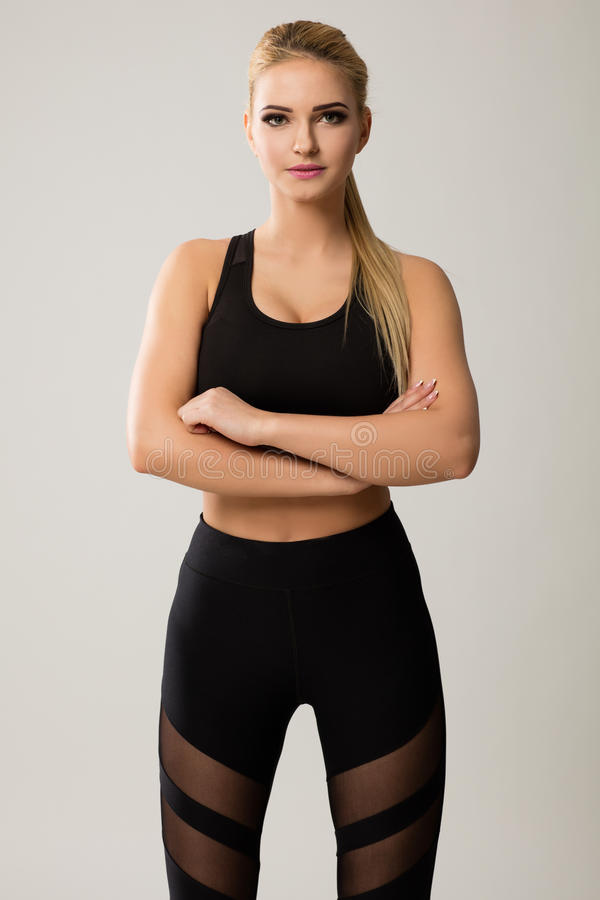 Blonde model in pony tail wearing black. stock image