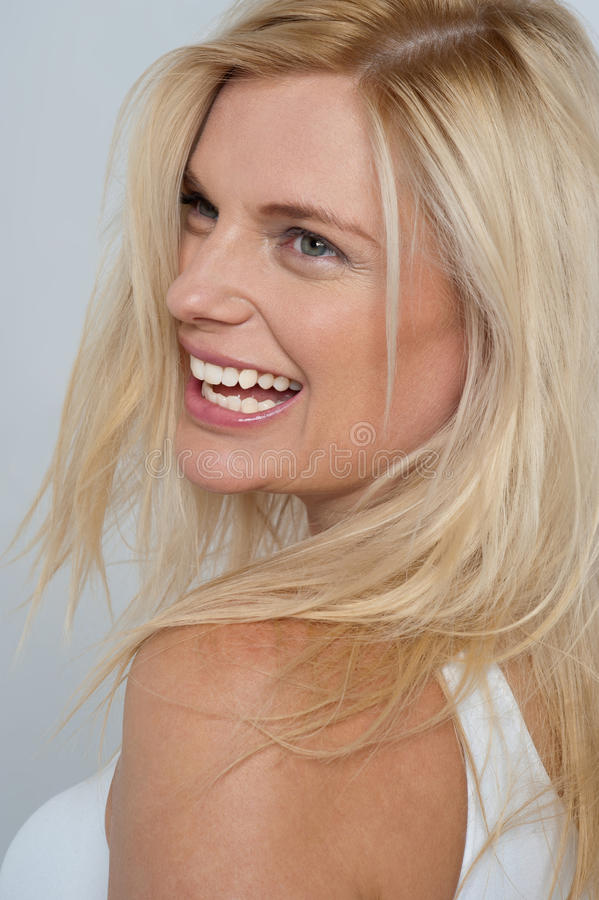 Free Blonde Model Turning Back And Laughing Royalty Free Stock Photos - 28421808